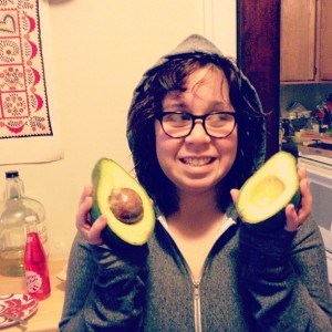 This is my roommate Gabbie holding a giant Florida Avocado.