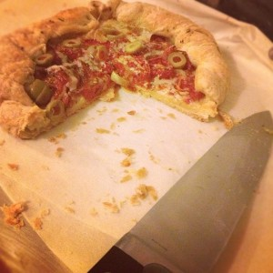 A literal pizza pie. Leftovers from a late pie night.